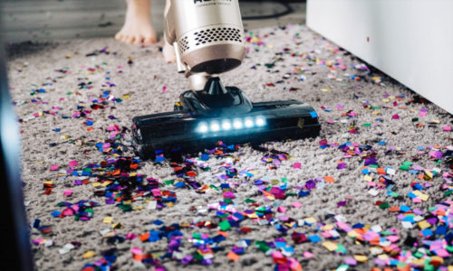 image of vacuum cleaning up confetti