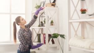 woman spring cleaning shelves