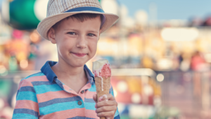 little boy eating a dripping ice cream cone