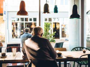 senior man sitting at table